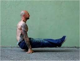 l-sit op de grond